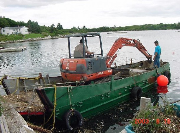 <span>Loading mini:</span> Loading mini excavator for trip to the island