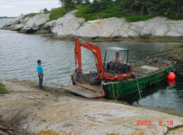 <span>Unloading:</span> Mini excatator arrives at the island